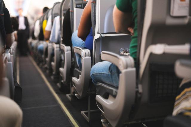 Air passengers sitting on plane