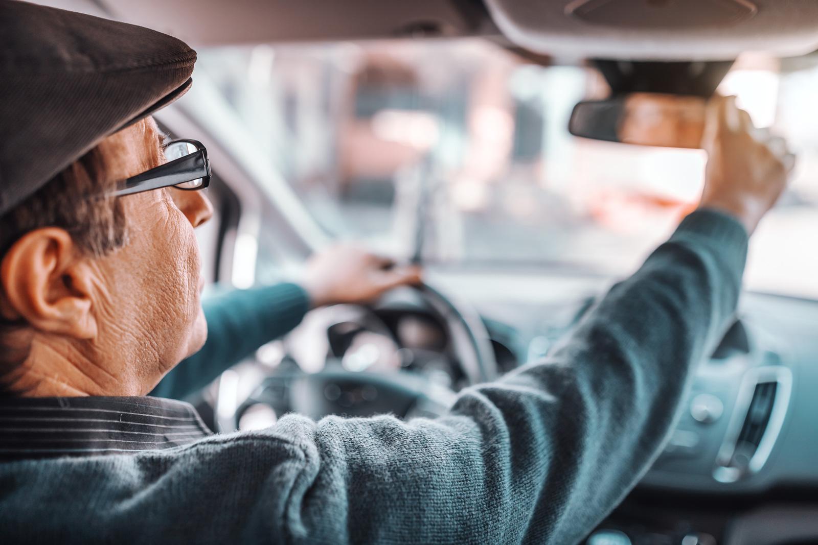 Senior adjusting rearview mirror