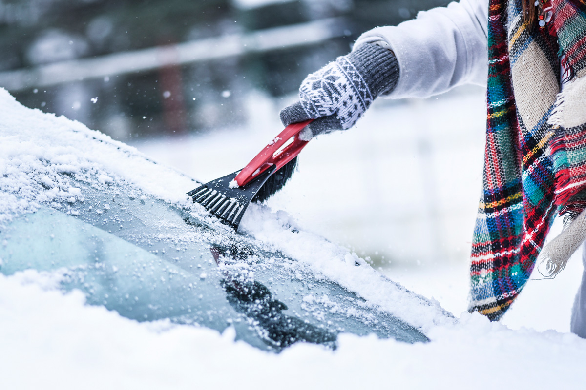 Winter Car Care Scraping Ice Off Windshield
