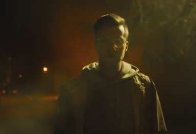 Man with glasses outside at night