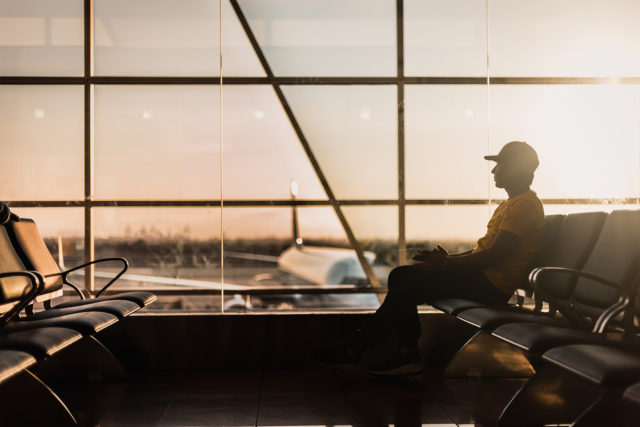 Person sitting in airport lounge