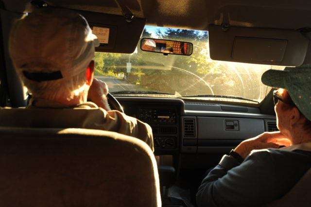 Senior couple sitting in a car driving