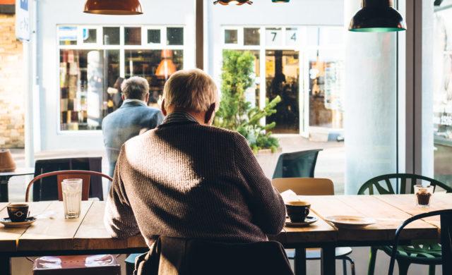 Senior sitting at a coffee shop