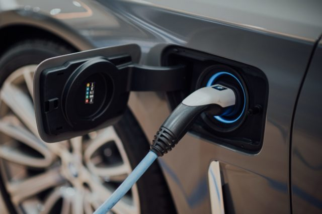 Electric vehicle with charging plug